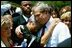 "President George W. Bush hugs a woman attending the Annual Peace Officers' Memorial Service at the U.S. Capitol in Washington, D.C., Saturday, May 15, 2004. ""I also thank all the family members who have come to Washington for this service. For each of you, there is a name on the National Law Enforcement Officers Memorial that will always stand apart. You feel the hurt of loss and separation, but I hope that you don't feel alone,"" said the President."