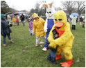 Cold days bring warm hugs as the Easter Bunny and his friends greets young visitors to a soggy South Lawn the 2005 White House Easter Egg Roll.