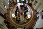 President George W. Bush hosts a meeting with senior advisers in the newly-renovated Oval Office, which includes a specially-designed wool rug featuring the Presidential coat of arms Dec. 20, 2001. The color scheme of the first Oval Office, built in 1909 during the Taft Administration, was olive green.