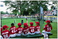 A Devil Dog cheers as a teammate rounds first base during the first game of the 2004 White House Tee Ball season June 13, 2004.