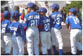 Standing outside of the South Portico, the Uniondale Little League Sluggers gather together before walking to the field. Prior to the game, the two teams and their guests toured the White House Sunday, May 5, 2002.