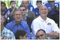 President George W. Bush and Commissioner Cal Ripken watch the game with team families Sunday, May 5, 2002. In addition to moms and dads, Arizona Diamondback Erubiel Durazo, and Major League Baseball Hall of Famers Tony Perez and Orlando Cepeda came to root for the two teams.