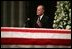 Former President George H.W. Bush delivers a eulogy for former President Ronald Reagan during the funeral service at the National Cathedral in Washington, DC on June 11, 2004.