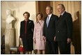 President George W. Bush and first lady Laura Bush are welcomed by King Albert II and Queen Paolo of Belgium at the palace office in Brussels, Monday, Feb. 21, 2005.