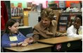 Mrs Bush greets Hainerberg Elementary School student Hailey Cook during her visit with fourth and fifth graders Tuesday, Feb. 22, 2005 in Wiesbaden, Germany.