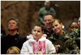 Audience members listen to a speech by Laura Bush praising the sacrifice and hard work of the U.S. military and their families Tuesday, Feb. 22, 2005 at Ramstein Air Base in Ramstein, Germany.