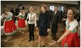 Laura Bush watches dancers during a Wednesday, Feb. 23, 2005, lunch hosted by Chancellor Gerhard Schroeder, behind, and Mrs. Schroeder-Koepf, left, at the Electoral Palace in Mainz, Germany.
