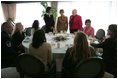 Mrs. Bush talks with spouses of deployed military during a luncheon Tuesday, Feb. 22, 2005, at Ramstein Air Base in Ramstein, Germany.