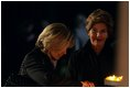 Laura Bush and Mrs. Schroeder-Koepf light candles during a tour of Saint Martin's Cathedral in Mainz, Germany, Feb. 23, 2005.