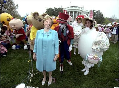 "Accompanied by all sorts of story book characters, Lynne Cheney the host of the 2003 White House Easter Egg Roll, addresses the media on the South Lawn Monday, April 21, 2003. ""But most of all, we are proud of all of you, the men and women who serve our country, who keep our country free,"" said Mrs. Cheney in her opening remarks welcoming U.S. military families to the event."