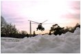 Marine One arrives from Camp David and lands on the South Lawn in an area cleared of snow, Sunday, Dec. 8, 2002.