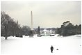 The President takes a walk in the snow on the South Lawn with his dog, Spot, Thursday, Dec. 5, 2002.
