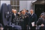"President Lyndon Johnson and General William Westmoreland speak to reporters in the ""stake out"" area outside the West Wing April 7, 1968."