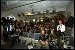 Reporters prepare for a press conference by President Bush in the James S. Brady Press Briefing Room, March 13, 2002.