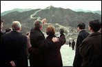 """President Bush and Mrs. Bush tour the Great Wall of China, Friday, Feb. 22, in Badaling, China. President Richard Nixon visited the same Badaling area of the wall during his trip to China. """"Thirty years ago, leaders of China and the United States acted together to put an end to mutual estrangement and open the gate for exchanges and cooperation between the two countries,"""" said Chinese President Jiang of the historic trip. White House photo by Eric Draper."""