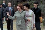 Mrs. Bush waves to members of the media and onlookers as she walks with Kiyoko Fukuda following a lunch and tea ceremony at Akasaka Palace Monday, February 18, 2002 in Tokyo. White House photo by Susan Sterner.