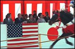 Prime Minister Junichiro Koizumi, far left, President George W. Bush, left, Laura Bush, second right, and Kiyoko Fukuda, far right, wife of the Japanese chief cabinet secretary, watch a demonstration of horseback archery during a visit to the Meiji Shrine in Tokyo, Monday, Feb. 18. White House photo by Susan Sterner.