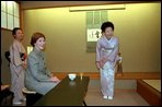 Mrs. Bush and hostess Kiyoko Fukuda, right, share a light moment at the conclusion of a tea ceremony held at Akasaka Palace Monday, February 18, 2002. White House photo by Susan Sterner.