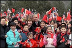 The President and Mrs. Bush pose with a group of Chinese children at the Great Wall of China in Badaling about an hour outside of Beijing, Friday, February 22, 2002. The children waved flags and sang for the Bushes. White House photo by Susan Sterner.