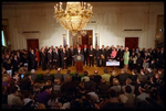 Joined by members of Congress and 15 American families in the East Room June 7, 2001, President George W. Bush signs the Tax Relief Act, which provides Americans with across-the-board tax cuts.