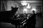 Former President Harry Truman tickles the ivories for President and Mrs. Kennedy in the East Room November 1, 1961.