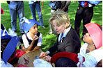 Mrs. Cheney talks to local students about George Washington and Benjamin Franklin during Constitution Day at the Naval Observatory in Washington, D.C. Sept. 17, 2002.