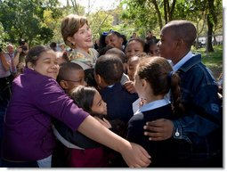 Mrs. Laura Bush receives a big group hug from children visiting from the Adam Clayton Powell Jr. Elementary School (P.S. 153) and the Boys and Girls Club of Harlem at the conclusion of a First Bloom program at the Hamilton Grange National Memorial in New York City, Sept. 24, 2008. The First Bloom program is a national conservation education program for the National Park Foundation that encourages young people to protect the environment in America's National Parks and in their own back yards. White House photo by Chris Greenberg