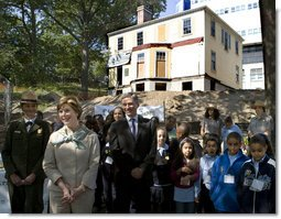 Mrs. Laura Bush stands with children from the Adam Clayton Powell Jr. Elementary School (P.S. 153) and the Boys and Girls Club of Harlem as she addresses media after participating in a First Bloom program at the Hamilton Grange National Memorial in New York City, Sept. 24, 2008. The plantings are part of the restoration efforts at the historic home of Alexander Hamilton. White House photo by Chris Greenberg
