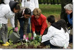 Mrs. Laura Bush helps children plant flowers at the First Bloom Event, Monday, April 21, 2008, during her visit to celebrate National Park week at the Castle Clinton National Monument in New York City. White House photo by Shealah Craighead