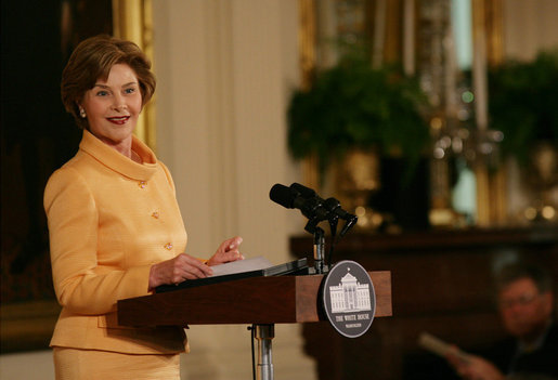 Mrs. Laura Bush welcomes guests to the East Room of the White House Monday, May 12, 2008, as she congratulates the recipients of the 2008 Preserve America Presidential Awards. The African Burial Ground Project, The Corinth and Alcorn County Mississippi Heritage Tourism Initiative, the Lower East Side Tenement Museum and the Texas Historic Courthouse Preservation Program were all honored for their efforts in preserving our national historic sites. White House photo by Allison Huff