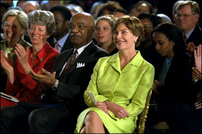 Laura Bush and Education Secretary Rod Paige listen to a speaker during the White House Conference on Character and Community, June 19, 2002. White House photo by Paul Morse.