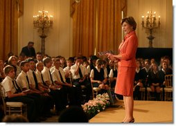 Mrs. Laura Bush welcomes a group of children to the East Room of the White House on Wednesday, Sept. 17, 2008, for an American history performance by the National Constitution Center to highlight the 221st anniversary of the signing of the United States Constitution. White House photo by Joyce N. Boghosian