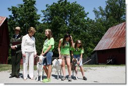 Mrs. Laura Bush meets students holding goats Monday, July 28, 2008, during a tour of the Old Goat Barn at the Carl Sandburg Home National Historic Site in Flat Rock, N.C. Mrs. Bush participated in Junior Ranger program events at the historical site and announced a $50,000 grant in support of the Junior Ranger programs. White House photo by Shealah Craighead