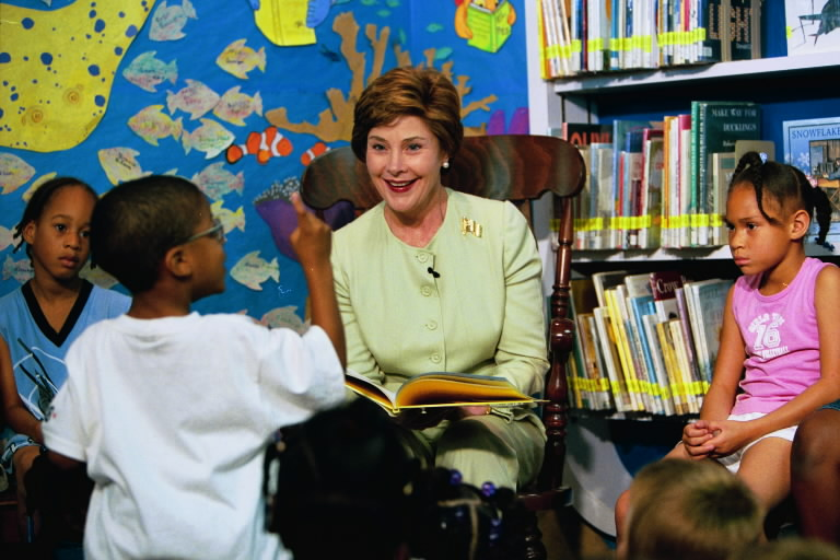 """Laura Bush answers questions from an excited listener during her reading of """"Book, Book, Book"""" at the Chattanooga-Hamilton Bicentennial Library in Chattanooga, Tenn. on June 12, 2003. White House photo by Susan Sterner"""