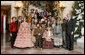 """President George W. Bush and Mrs. Laura Bush pose for a photo with the Ford's Theater cast members of """"A Christmas Carol,"""" following their performance Monday, Dec. 3, 2007, at the White House Children's Holiday Reception. White House photo by Shealah Craighead"""
