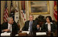 President George W. Bush is joined by Walter Isaacson, President and CEO, Aspen Institute, and Tahani Abu Daqqa, Palestinian Minister of Youth and Sports, during a meeting Monday, Dec. 3, 2007, with U.S.-Palestinian Public-Private Partnership in the Roosevelt Room of the White House. The partnership is aimed at promoting economic opportunity and leadership development for Palestinian youth. White House photo by Eric Draper