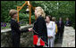 Mrs. Laura Bush greets the directors of Presidential Libraries Wednesday, June 4, 2008, at the entrance to Camp David's Evergreen Chapel in Thurmont, Maryland. Mrs. Bush shakes hands with Ms. Nancy Smith, Director of the National Archives' Presidential Material Staff in Alexandria, VA. White House photo by Shealah Craighead