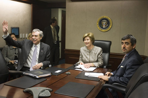 Mrs. Laura Bush acknowledges the Ladies in White during a video teleconference Thursday, Oct. 16, 2008, in the Situation Room of the White House. Mrs. Bush is joined by U.S. Secretary of Commerce Carlos Gutierrez, waving left, and interpreter Manuel Quiroz. Mrs. Laura Bush conveyed her continuous commitment, and that of the President, to support the Cuban people's aspirations for freedom. White House photo by Joyce N. Boghosian