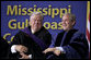 """President and Mississippi Governor Haley Barbour attend the 2006 graduation class at Mississippi Gulf Coast Community College in Biloxi, Miss., Thursday, May 11, 2006. """"You continued your studies in classrooms with crumbling walls. You lost homes, and slept in tents near campus to finish courses,"""" said the President speaking about the students' experiences. """"You cleared debris during the day and you went to class at night."""" White House photo by Paul Morse"""