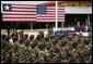 President George W. Bush and Liberian President Ellen Johnson Sirleaf review Liberian troops Thursday, Feb. 21, 2008, during President Bush's visit to the Barclay Training Center in Monvoria, Liberia. White House photo by Shealah Craighead