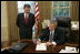 President George W. Bush signs the nomination papers in the Oval Office, Monday morning, Sept. 5, 2005, to nominate U.S. Supreme nominee John Roberts to become Chief Justice.
