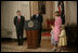 President George W. Bush announces Judge John G. Roberts as the President's nominee for Supreme Court Associate Justice, July 19, 2005 in the East Room of the White House. Roberts family members: wife, Jane Marie Sullivan Roberts; son, Jack, 4, and daughter, Josephine (Josie), 5, are seen at right.