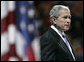"""President George W. Bush addresses his remarks during the Convocation Tuesday, April 17, 2007 in Blacksburg, Va., honoring the students, faculty and staff who died or were injured in Monday's tragic shooting at Virginia Tech. President Bush said, """"It's impossible to make sense of such violence and suffering."""" White House photo by Eric Draper"""