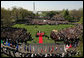 President George W. Bush and Pope Benedict XVI, seen from Truman Balcony of the White House, stand together on the reviewing stand during the welcoming ceremony for the Pope on the South Lawn of the White House Wednesday, April 16, 2008. White House photo by Joyce N. Boghosian