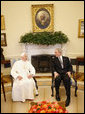 President George W. Bush and Pope Benedict XVI meet in the Oval Office Wednesday, April 16, 2008, following the Pope's welcoming ceremony on the South Lawn of the White House. White House photo by Eric Draper