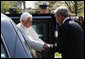 President George W. Bush shakes hands with Pope Benedict XVI on his arrival to the White House Wednesday, April 16, 2008, for the welcoming ceremony on the South Lawn in honor of the Pope's visit to the United States. White House photo by Eric Draper