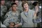 Mrs. Laura Bush poses for a photo with a US soldier during her visit to Bagram Air Force Base Sunday, June 8, 2008, in Bagram, Afghanistan. White House photo by Shealah Craighead