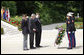 President George W. Bush is flanked by two U.S. World War II Veterans during wreath-laying ceremonies Saturday, June 14, 2008, at the Suresnes American Cemetery and Memorial in Suresnes. White House photo by Eric Draper