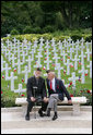 Military veterans sit on a bench at the Suresnes American Cemetery and Memorial in Paris on Saturday, June 14, 2008, awaiting the arrival of President George W. Bush. White House photo by Chris Greenberg