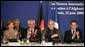 Mrs. Laura Bush joins in the applause during the International Conference in Support of Afghanistan Thursday, June 12, 2008 in Paris, where Mrs. Bush addressed the conference urging continued support for the Afghanistan people to build civic and economic institutions that can withstand the forces of oppression. Mrs. Bush is joined on the panel, from left, Afghanistan Foreign Minister Dr. Rangin Dadfar Spanta, Afghanistan President Hamid Karzai and French President Nicholas Sarkozy. White House photo by Shealah Craighead
